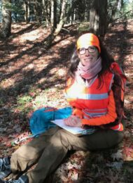 Christine surveying woodlot in Hubbardston Massachusetts