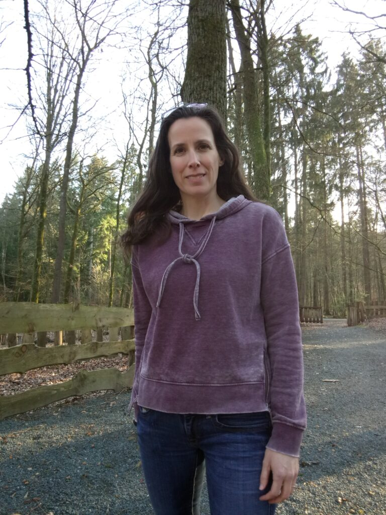 English in Nature Founder Christine outdoors in forest at sunset